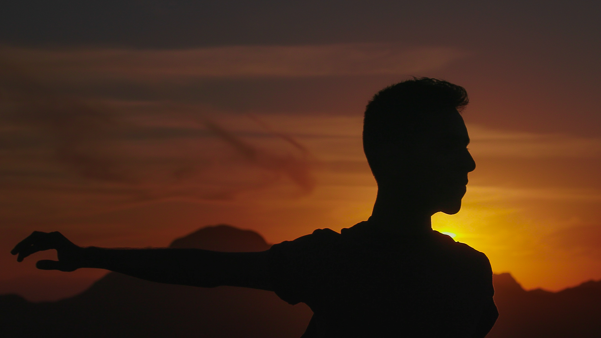 Man dancing in sunset