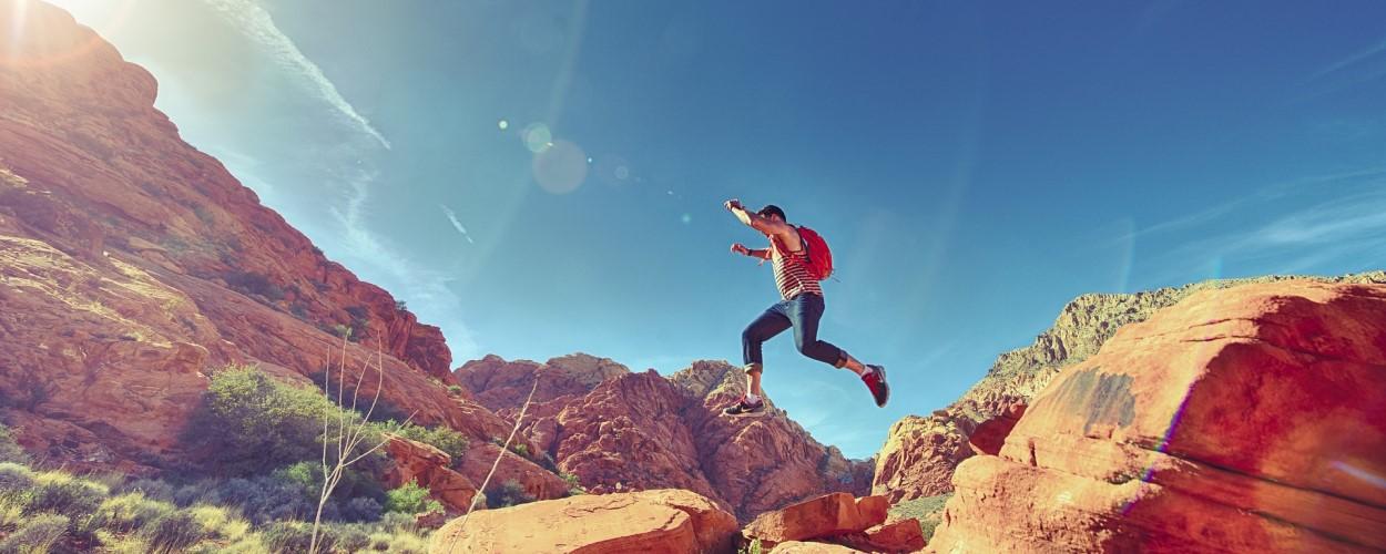 Man Jumping Boulders Joyfully