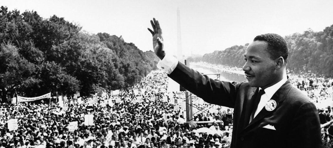 March on Washington-MLK Jr hand raised in greeting