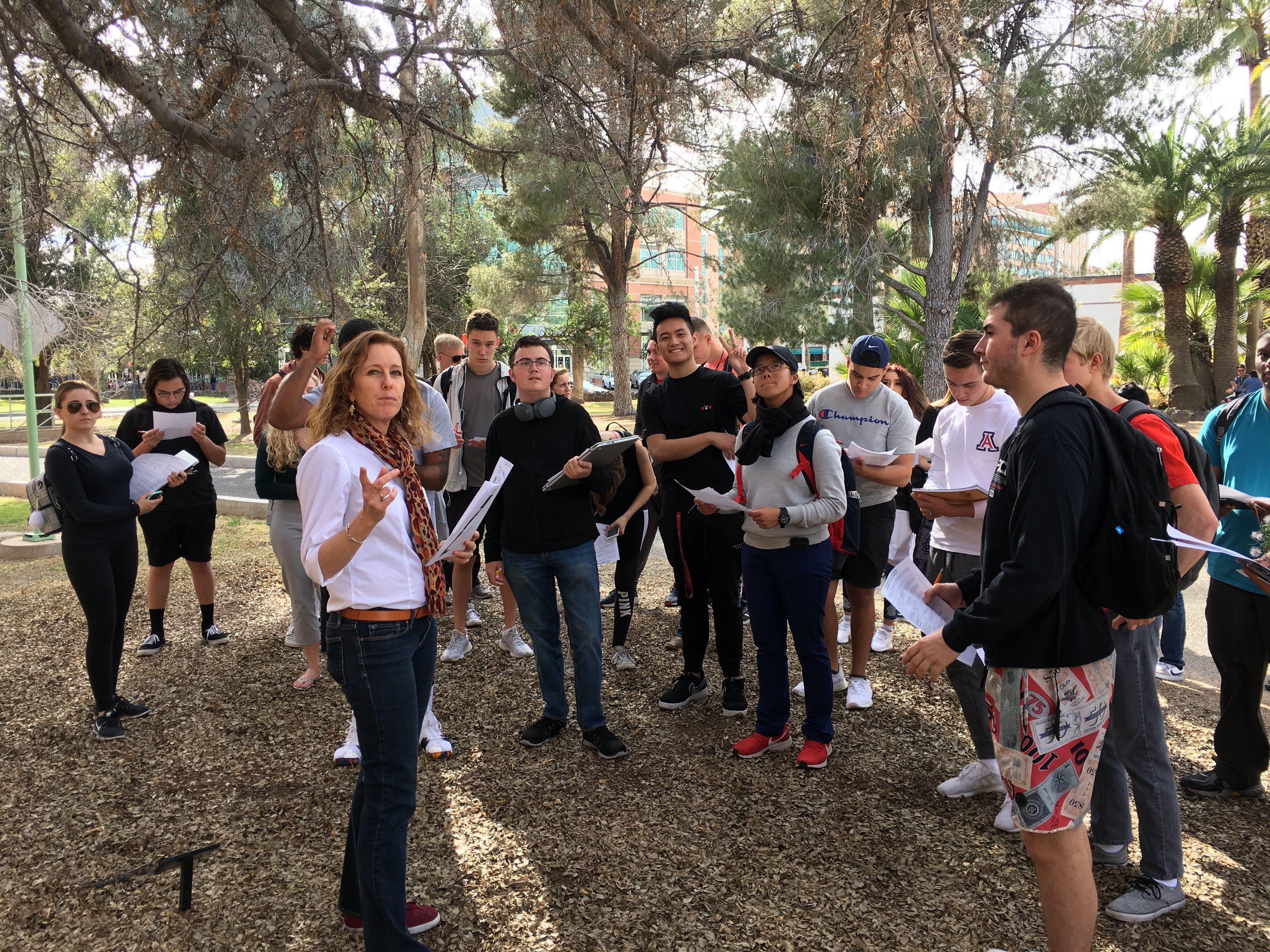 Mullins leading her Sustainable Nutrition and Food Systems class through a tour of edible trees on campus.