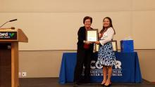Sharon Megdal presents Karletta Chief the Friend of UCOWR Award.