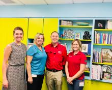 Kim Christman, second from left, and members of her Maricopa County Cooperative Extension 4-H team, Hannah Hanson and Taylor Hubbard, with UA Vice President for Agriculture, Life and Veterinary Sciences, and Cooperative Extension Shane Burgess.