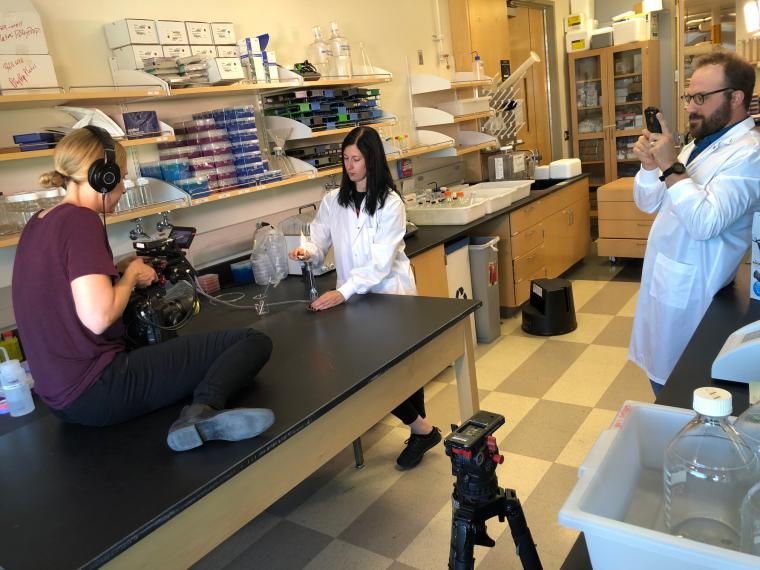 Producer shoots scene in a lab