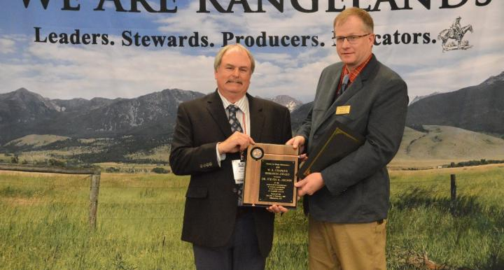 Dr. Steven Archer receiving the 2019 W. R. Chapline research Award from Society for Range Management President Dr. Barry Irving.