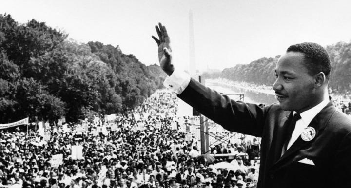 March on Washington-MLK Jr hand raised in greeting